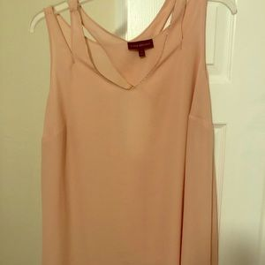 Blush sleeveless blouse with cute back detail